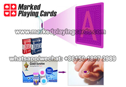 marked playing cards with contact lenses